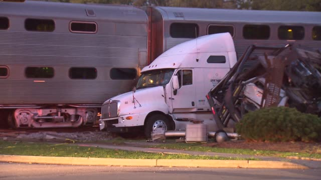 a semi truck hauling new cars was hit by an inbound train two passengers suffered minor injuries train collision with a semi truck on october 21 2013... - 交通事故点の映像素材/bロール