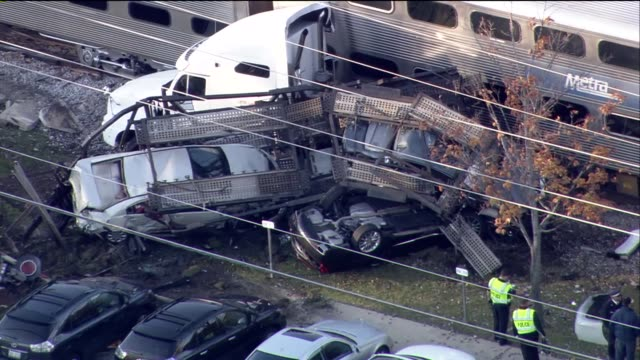 a semi truck hauling new cars was hit by an inbound train two passengers suffered minor injuries aerial of train collision with a semi truck on... - train crash stock videos and b-roll footage