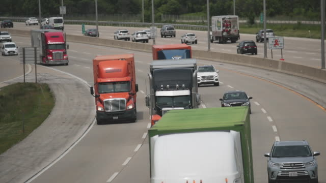 semi trucks travel along i94 on june 21, 2019 near lake forest, illinois. the trucking industry in 2019 has experienced a drop in demand from 2018... - major road video stock e b–roll