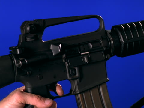 semi-automatic closeup; firing - unknown gender stock videos & royalty-free footage
