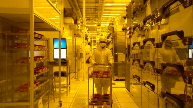 semiconductor manufacturing at globalfoundries facility, employees wearing protective suits in singapore city, singapore, on tuesday, may 18, 2021. - singapore stock videos & royalty-free footage