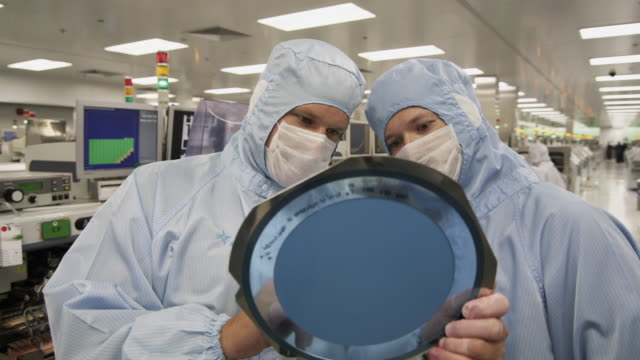 cu semiconductor technicians inspecting wafer of integrated circuit boards / bang pa-in, ayutthaya, thailand - wafer stock videos and b-roll footage