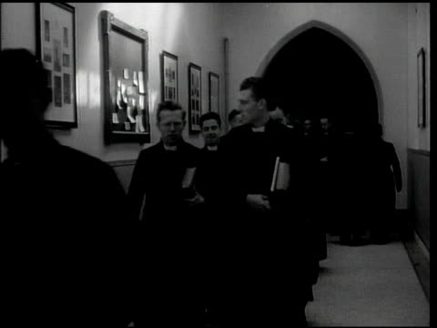 seminary students in clerical clothing walking down seminary hallway w/ books, vs seminary students in clerical clothing in classroom, at desks,... - maynooth stock videos & royalty-free footage