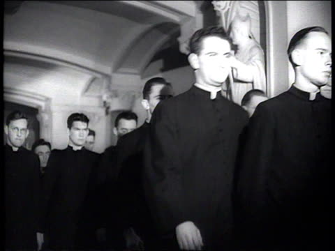 1941 la seminary students walking down the hall at st. joseph's seminary/ fordham university, new york, new york - katholizismus stock-videos und b-roll-filmmaterial