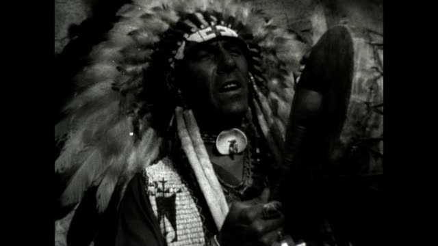 a seminole native american wearing a headdress plays the drums and chants - native american ethnicity stock videos & royalty-free footage