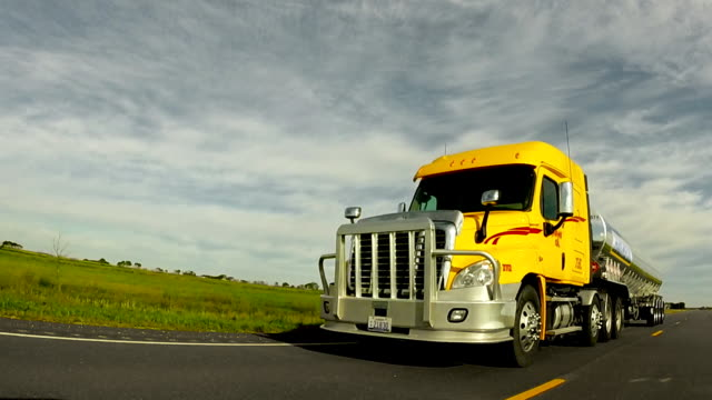 semi-truck driving on the open road - articulated lorry stock videos & royalty-free footage