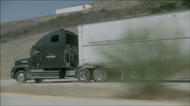 TS A semi-truck driving wildly down a desert highway / Los Angeles, California, United States