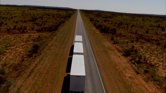 a semi-truck tows three large trailers. - articulated lorry stock videos & royalty-free footage