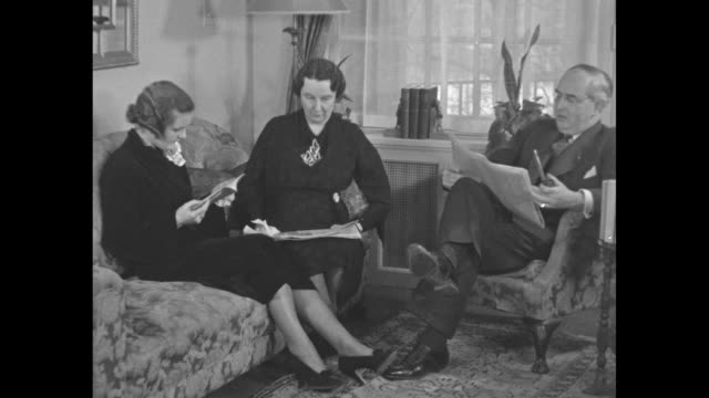us sen arthur vandenberg looks at newspaper as he sits with wife hazel and daughter in living room his house in washington dc sot vandenberg re... - hazel eyes stock videos & royalty-free footage