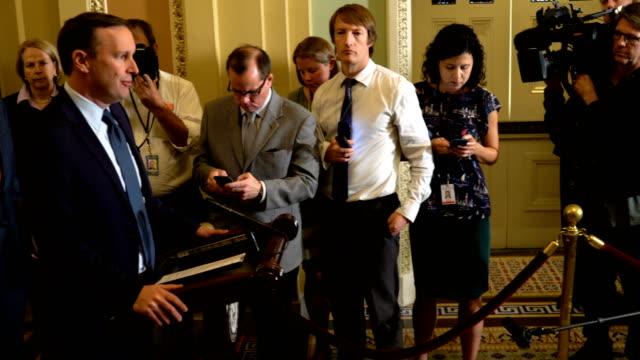 us sen chris murphy speak as sen tammy baldwin and senate minority leader sen chuck schumer listen during a news briefing after a weekly senate... - ジャーナリズム点の映像素材/bロール