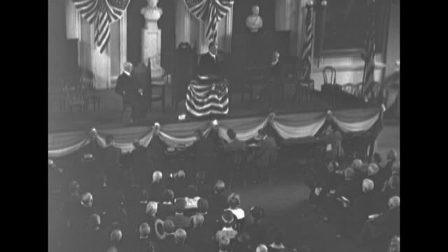 sen hiram johnson speaks from a platform decorated with bunting / long elevated pans of the crowd listening and applauding during the event at... - 1910 1919 stock videos and b-roll footage