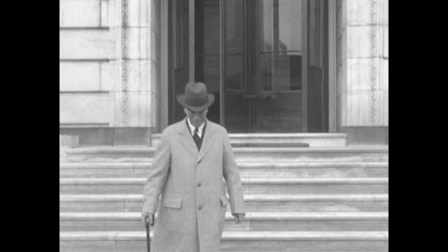 Sen Samuel Shortridge member of Naval Affairs Committee walking down steps of building then stopping and posing for photo opportunity / closer shot...