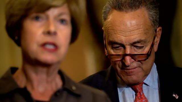 US Sen Tammy Baldwin and Sen Chris Murphy speak as Senate Minority Leader Sen Chuck Schumer listens during a news briefing after a weekly Senate...