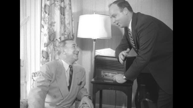 stockvideo's en b-roll-footage met ma sen william purtell confers with man next to radio broadcasting election results - amerikaanse presidentsverkiezingen