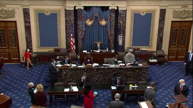 senate clerk reads out in exotic new year's day session cloture motion to bring to close debate on the veto message to accompany the fiscal year 2021... - 米国国防総省点の映像素材/bロール