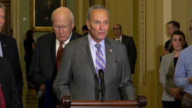 senate democratic leader chuck schumer of new york answers a reporter question about economic issues which he responded to by saying the democrats... - lowering stock videos & royalty-free footage