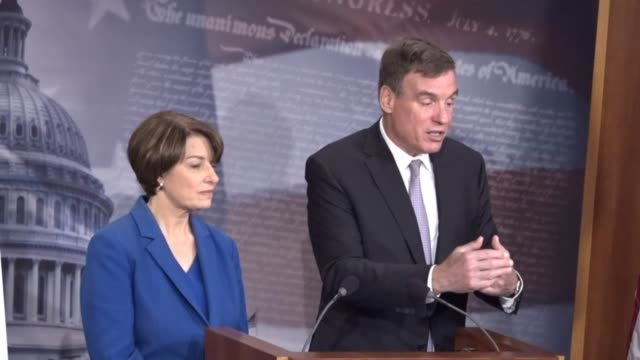 Senate Intelligence Committee Vice Chairman Mark Warner joins Minnesota Senator Amy Klobuchar at a news conference to discuss legislation introduced...
