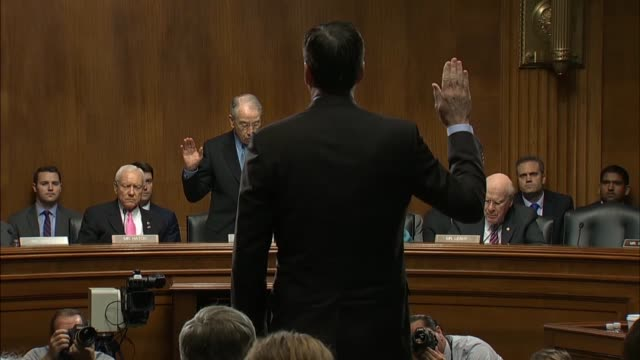 senate judiciary committee chairman chuck grassley administers the oath to fbi director james comey joking no introduction was needed - senate judiciary committee stock videos & royalty-free footage