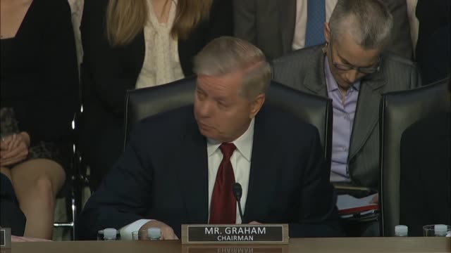 senate judiciary committee chairman lindsey graham reads a communication by an investigator at a hearing with justice department inspector general... - michael horowitz stock videos & royalty-free footage