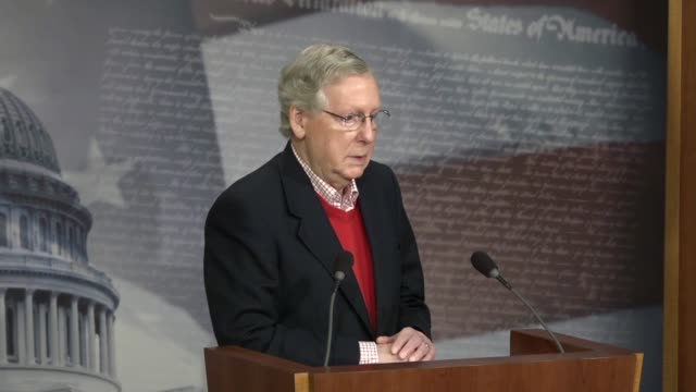 Senate Majority Leader Mitch McConnell answers a reporter's question at a yearend press conference about investigations into Russian election...