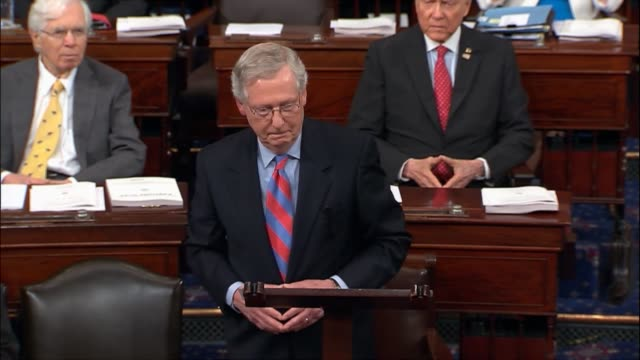 senate majority leader mitch mcconnell of kentucky speaks on the floor with senators present after a dramatic vote defeating the health care freedom... - collegio elettorale video stock e b–roll