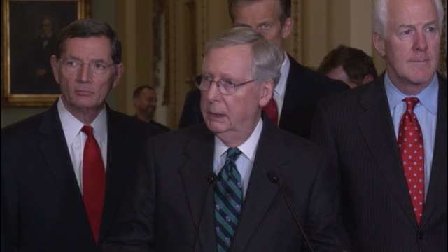 senate majority leader mitch mcconnell of kentucky tells reporters that he expects the senate foreign relations committee to report a sanctions bill... - 制裁点の映像素材/bロール