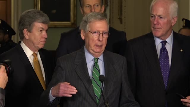 Senate Majority Leader Mitch McConnell takes questions from reporters at a weekly briefing about budget and immigration talks that even having an...