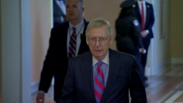 Senate Majority Leader Mitch McConnell walks by the Ohio Clock to the Senate chamber as President Donald Trump meets with Senate Republicans at a...