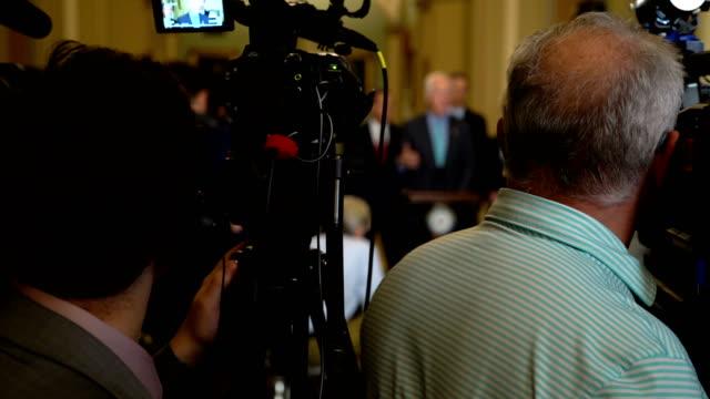 US Senate Majority Whip Sen John Cornyn speaks to members of the media as Senate Majority Leader Sen Mitch McConnell Sen John Barrasso and Sen John...