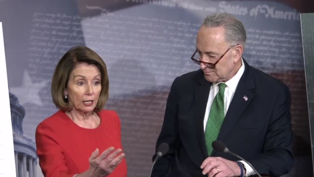 Senate Minority Leader Chuck Schumer answers questions from reporters at a briefing hours after the Tax Cuts and Jobs Act passed suggesting that...