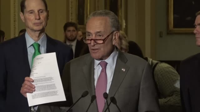 senate minority leader chuck schumer of new york begins a weekly press briefing with reporters by describing a letter written by his caucus to... - financial accessory stock videos & royalty-free footage