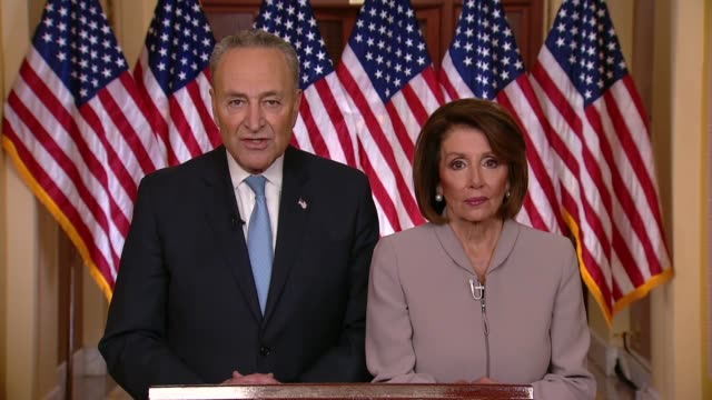 Senate Minority Leader Chuck Schumer of New York follows a televised address of President Donald Trump on the 18th day of a partial government...