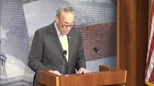 Senate Minority Leader Chuck Schumer of New York reads a statement at a press briefing the morning after the Department of Justice admitted that...