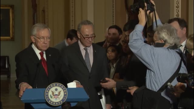 senate minority leader harry reid of nevada is questioned by reporters at a weekly press briefing about the posture of senate republicans towards an... - posture stock videos and b-roll footage