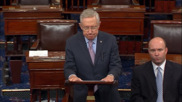 Senate Minority Leader Harry Reid of Nevada says during a senate session that Obamacare is a signature issue of the Obama administration commenting...