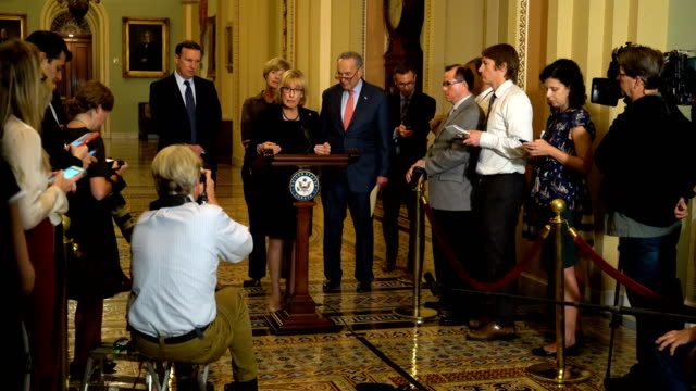us senate minority leader sen chuck schumer takes questions after sen maggie hassan spoke as sen tammy baldwin and sen chris murphy listen during a... - usa:s senat bildbanksvideor och videomaterial från bakom kulisserna