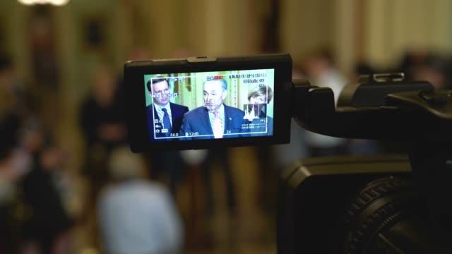 US Senate Minority Leader Sen Chuck Schumer takes questions as Sen Maggie Hassan Sen Chris Murphy and Sen Tammy Baldwin listen during a news briefing...