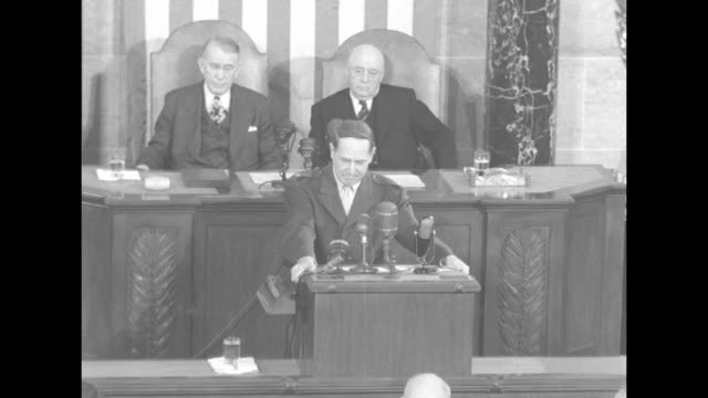Senate president Alben Barkley and president pro tem Kenneth McKellar sit behind General Douglas MacArthur as he addresses a joint session of...