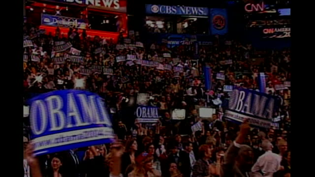 bid for Presidency EXACT Supporters holding up 'Obama 2004' signs at mass rally Obama making speech at rally
