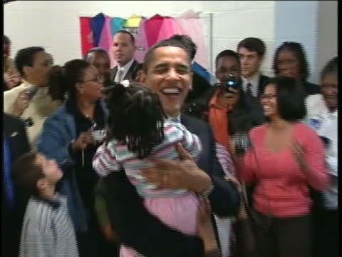 senator barack obama holds a young girl in his arms at church in darlington, south carolina during his 2008 campaign for the presidency. - 2008 stock videos & royalty-free footage