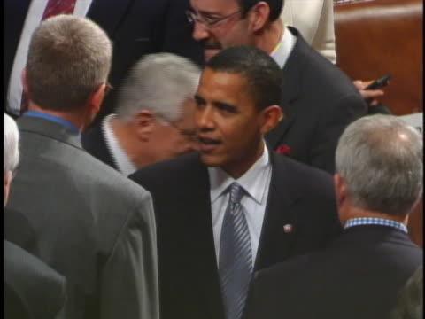 senator barack obama talks with a legislator on the floor of the house of representatives before the 2005 state of the union address. - legislator stock videos & royalty-free footage