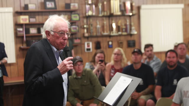 vídeos de stock, filmes e b-roll de senator bernie sanders, who is running for the democratic nomination for president of the united states, says that if elected as president he will... - bernie sanders