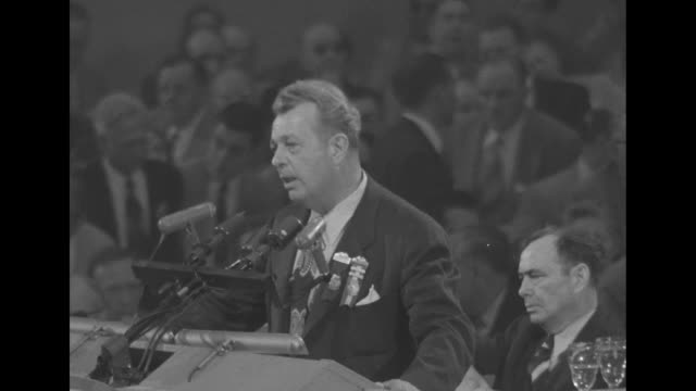 MS Senator Everett Dirksen at podium in front of microphones waiting for noise to quiet down convention chairman Joseph Martin Jr rises and strikes...