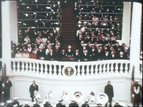 vídeos de stock, filmes e b-roll de senator everett dirksen introducing reverend billy graham at inauguration ceremony for richard nixon / men and women in crowd with heads bowed during... - tomada de posse