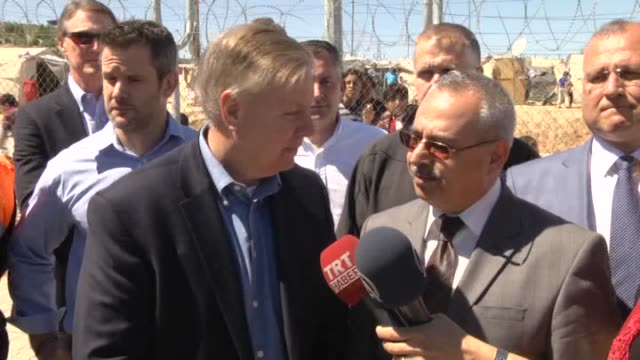S Senator for South Carolina Lindsey Graham and U2's Bono seen during a visit to a tent city of Syrian refugees in Nizip district of Turkey's...