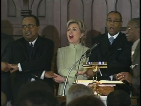 senator hillary rodham clinton sings with members of the southern christian leadership conference at a church in selma, alabama. - アメリカ公民権運動点の映像素材/bロール