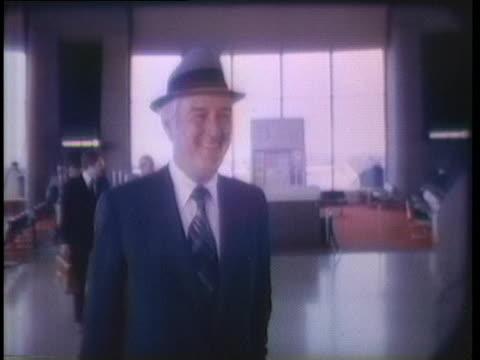us senator howard baker speaks to reporters and former governor and treasury secretary john connally walks - john connally stock videos & royalty-free footage