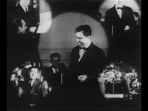 vídeos y material grabado en eventos de stock de us senator huey long 's friend o k allen gestures at long's childhood home / singleshot montage of long speaking greeting women working with wood... - paramount building