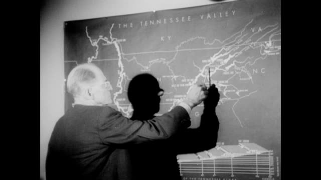 / senator james p polk points to tennessee river valley on a map / polk meeting with other interested parties to discuss the issue of the tennessee... - university of tennessee stock videos and b-roll footage