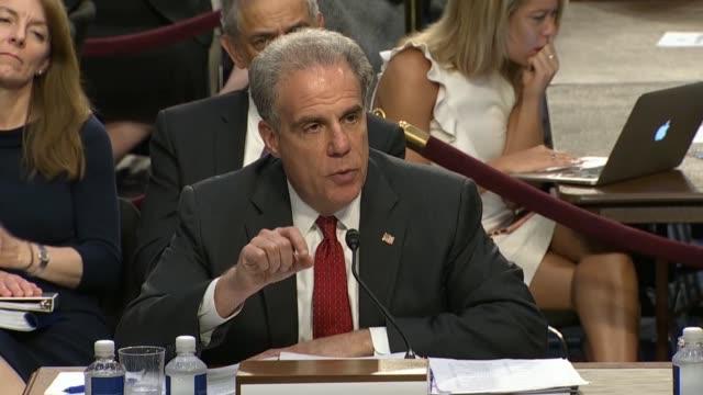 senator john cornyn of texas questions doj inspector general michael horowitz at the senate judiciary committee in a hearing on the doj and fbi... - text messaging video stock e b–roll